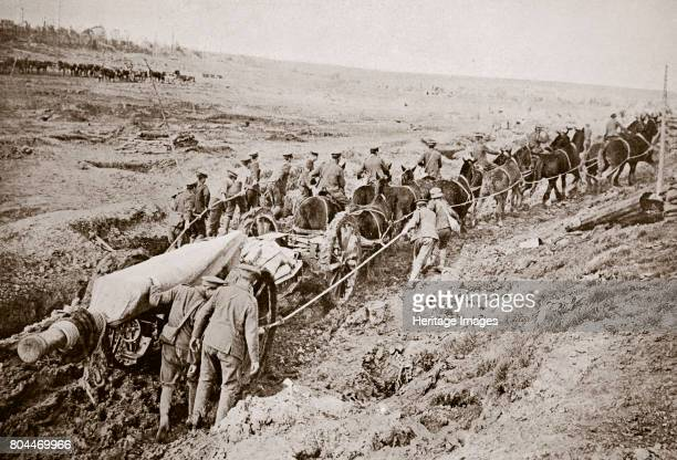 Pulling a big gun with a twelve horse team and the help of the gun crew France World War I 1916 During the Battle of the Somme Artist Unknown