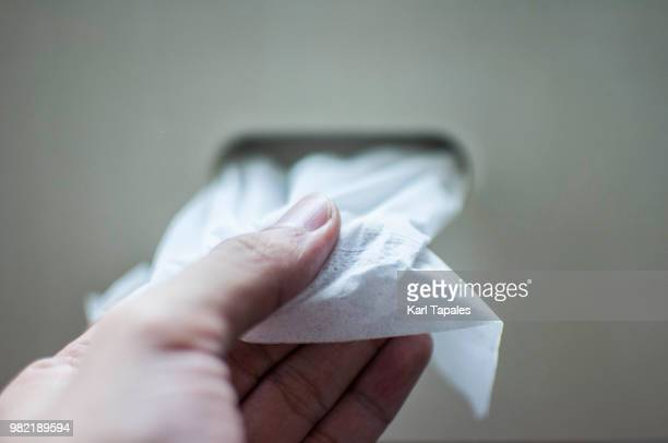 pulling a tissue paper - napkin stock pictures, royalty-free photos & images