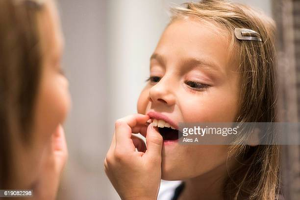 pulling a tooth out - girl strips stock pictures, royalty-free photos & images
