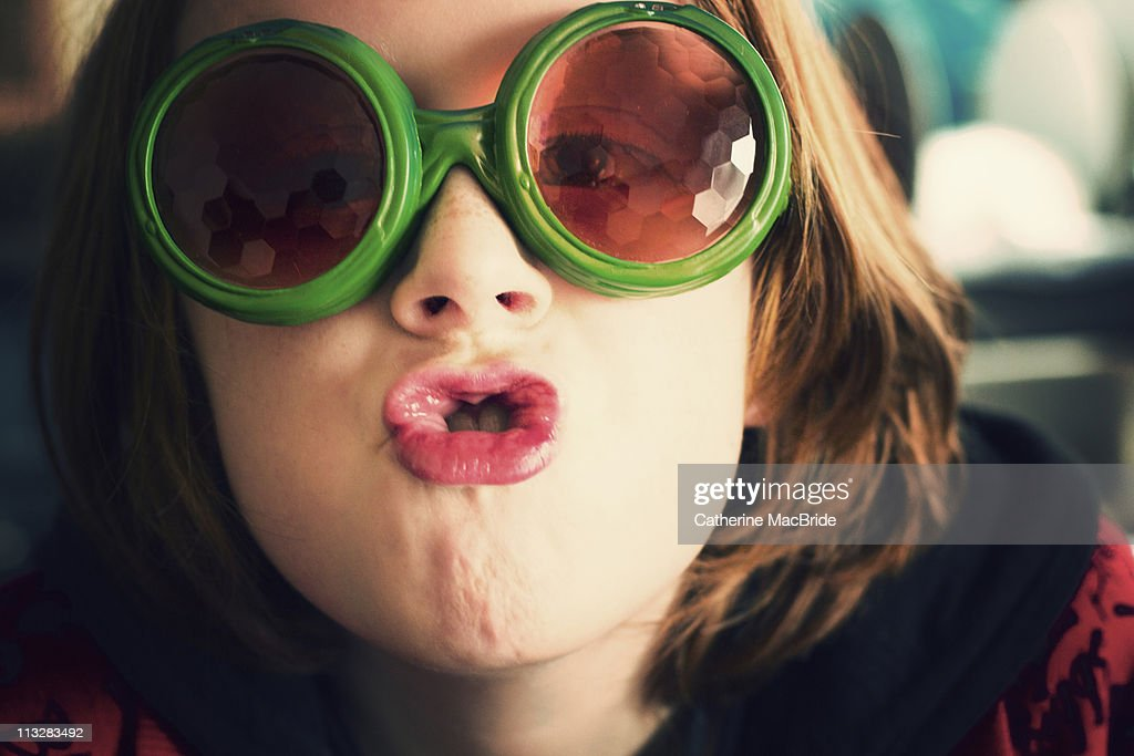 Pulling faces : Stock Photo