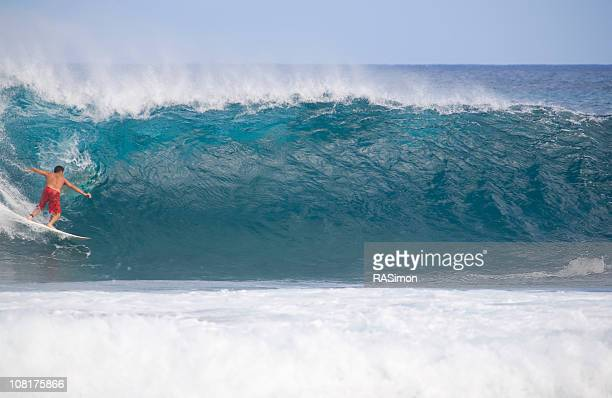 pulling in - first photo - big wave surfing stock pictures, royalty-free photos & images