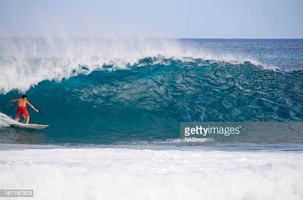 pulling in - second photo - big wave surfing stock pictures, royalty-free photos & images
