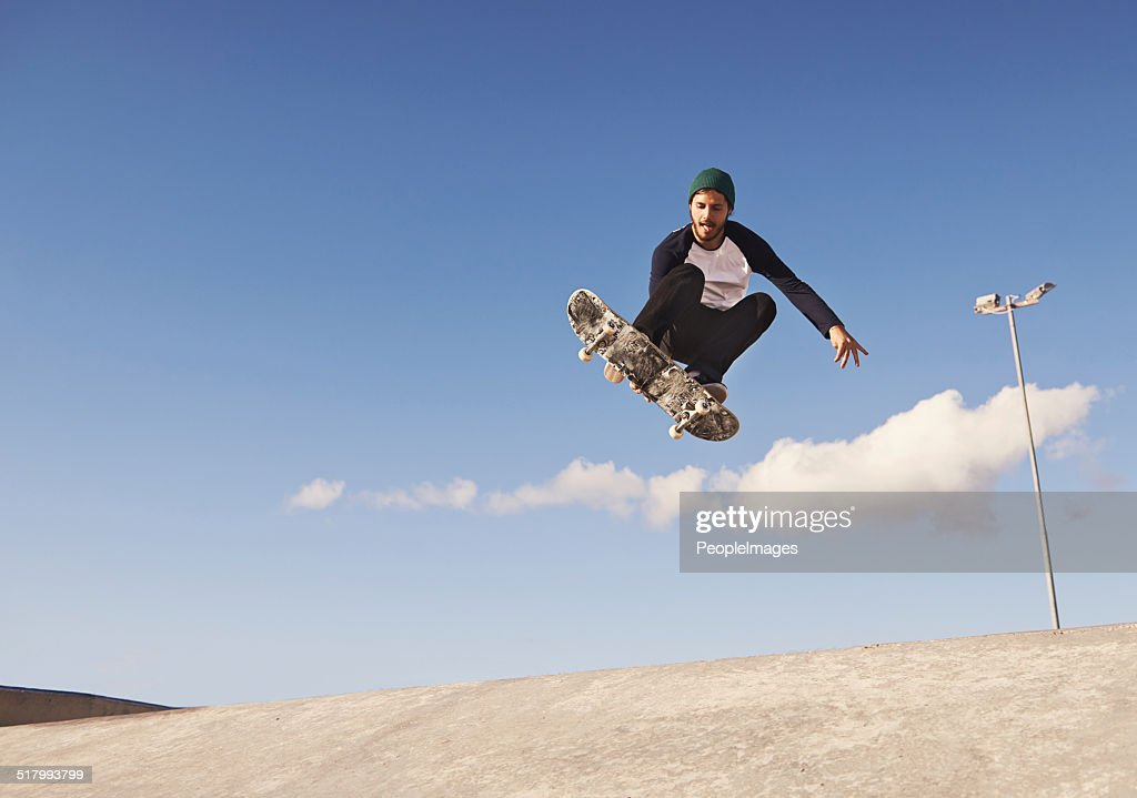 Pulling off a sick trick : Stock Photo