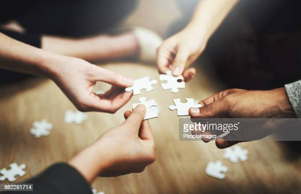 pulling together to solve a problem - solution stock pictures, royalty-free photos & images