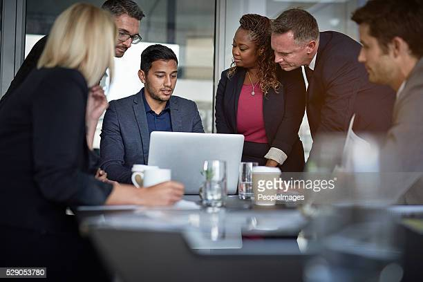 pulling up the presentation - peopleimages stock pictures, royalty-free photos & images