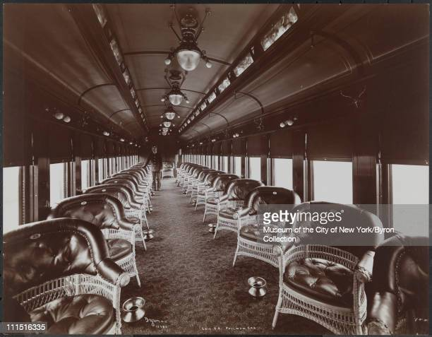 Pullman car on an Erie Railroad Co train wicker chairs spittoons and porter New York New York 1903