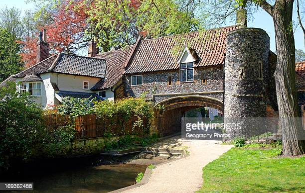 Pulls Ferry Norwich England, located on the River Wensum and is one of the most famous landmarks in Norwich. It is a flint building and was once a...