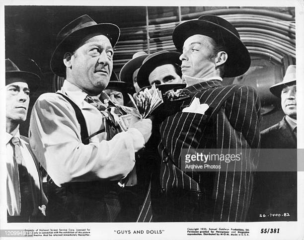 BS Pully pulls on the lapel of Frank Sinatra in a scene from the film 'Guys And Dolls' 1955