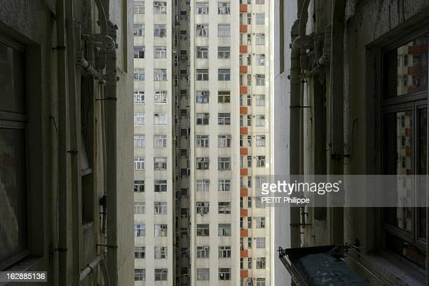 Hong Kong City Of Fear. HONG KONG principal foyer du Syndrome respiratoire aigu sévère : tuyauteries et eaux usées le longs de bâtiments autour du...