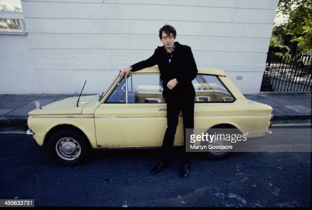 Pulp singer Jarvis Cocker portrait standing by a Hillman Imp car London United Kingdom 1991