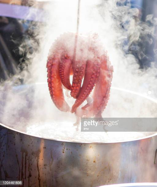 pulpo a feira - boiled octopus in fair - boiled stock pictures, royalty-free photos & images