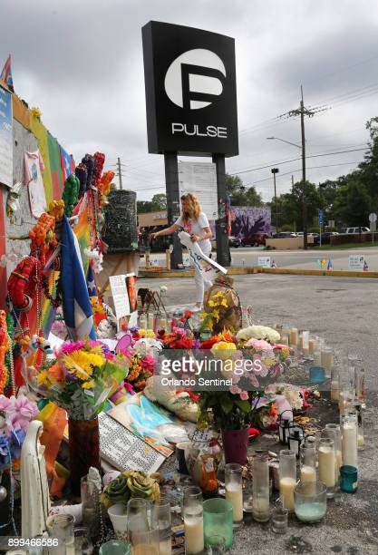 Pulse nightclub owner Barbara Poma tends to the memorial in front of her club on June 10 in Orlando Fla