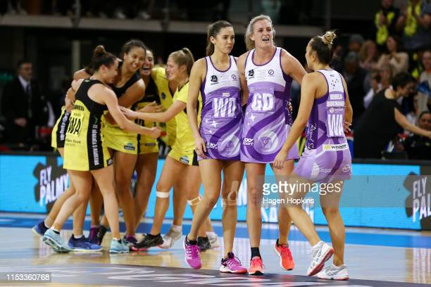Pulse players celebrate while Kayla Cullen and Leana De Bruin of the Stars look on in disappointment after winning the ANZ Premiership Netball Final...