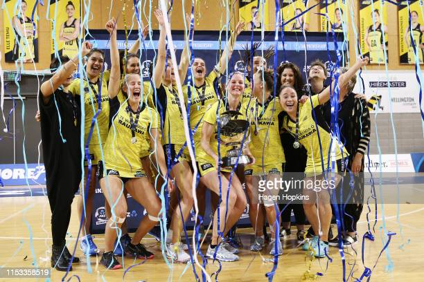 Pulse players celebrate with the ANZ Premiership trophy after winning the ANZ Premiership Netball Final between the Pulse and the Stars at Te...