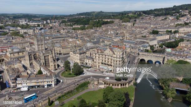 Pulteney Bridge which spans the River Avon in the centre of the historic city of Bath is seen from the air on June 13, 2021 in Bath, England. Bath, a...