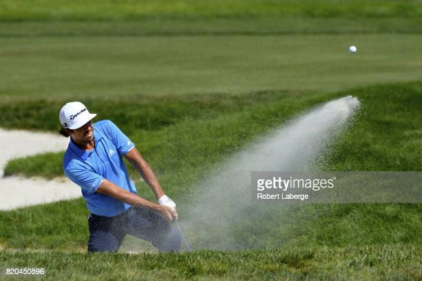 Puma Dominguez of Argentina makes a shot out of a bunker on the eight hole during round two of the Webcom Tour Pinnacle Bank Championship on July 21...