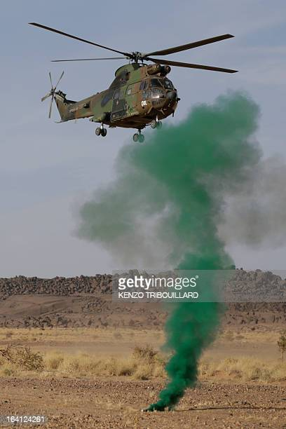 A Puma helicopter of the French Army lands in the Adrar of the Ifoghas mountain range in Mali on March 17 2013 AFP PHOTO / KENZO TRIBOUILLARD