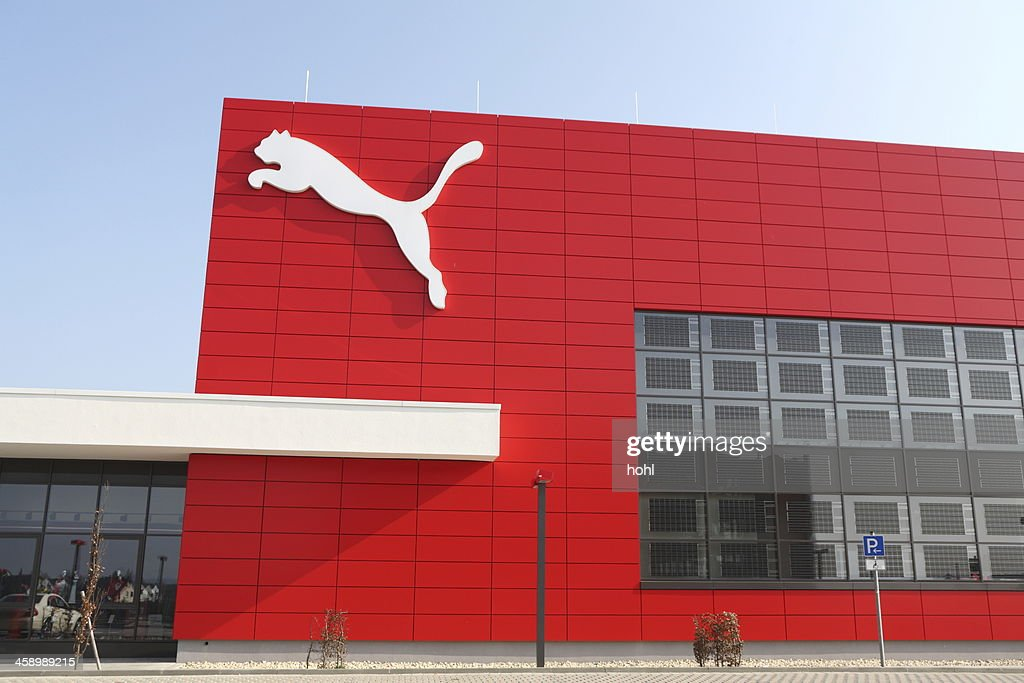 Puma logo on red wall : Stock Photo