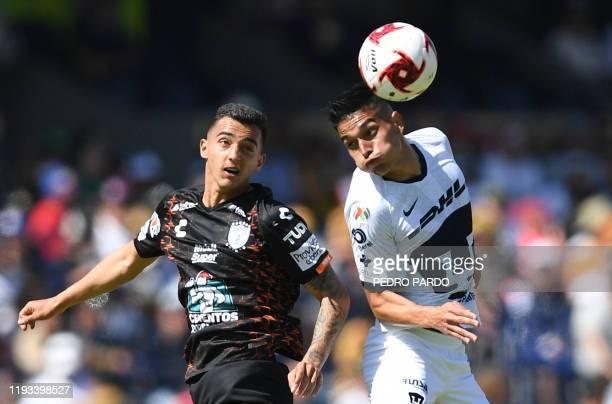 Pumas' Argentine midfielder Favio Alvarez vies for the ball with Pachuca's midfielder Luis Chavez during their Mexican Clausura football tournament...