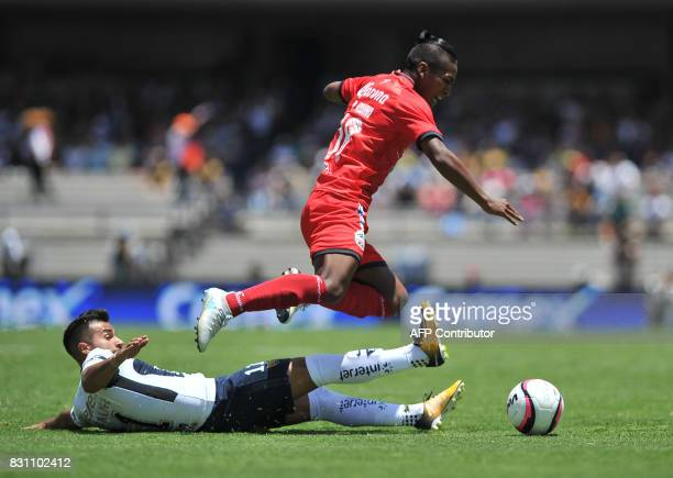 Pumas' Bryan Rabello vies for the ball with Lobos Buap's Pedro Aquino during their Mexican Torneo Apertura 2017 football match at the University...