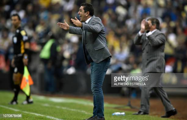 Pumas coach David Patino gestures during the second round of semifinals of the Mexican Apertura tournament football match at the Azteca stadium on...