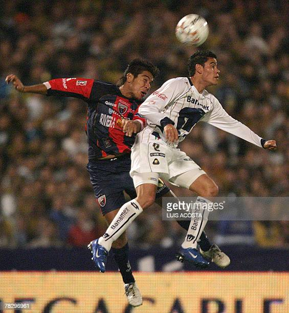 Pumas' Efrain Velarde vies for the ball with Atlante's Fernando Herrera during their Mexican league Final first match in Mexico City 06 December 2007...