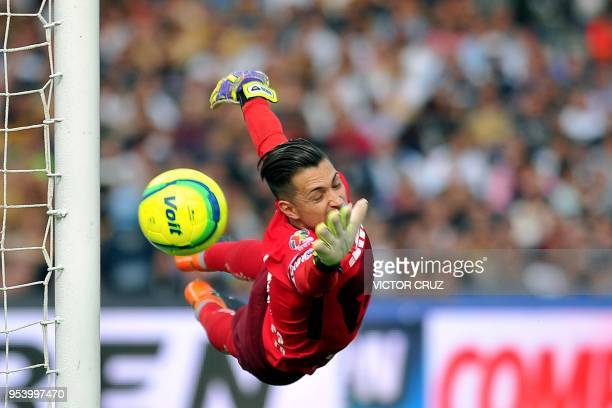 TOPSHOT Pumas' goalkeeper Alfredo Saldivar dives for the ball during the match against America during their quarter final first leg Mexican Clausura...