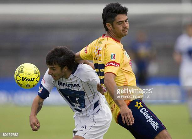 Pumas' Ignacio Scocco vies for the ball with Morelia's Horacio Cervantes during their Mexican league's football match in Mexico City on March 9 2008...