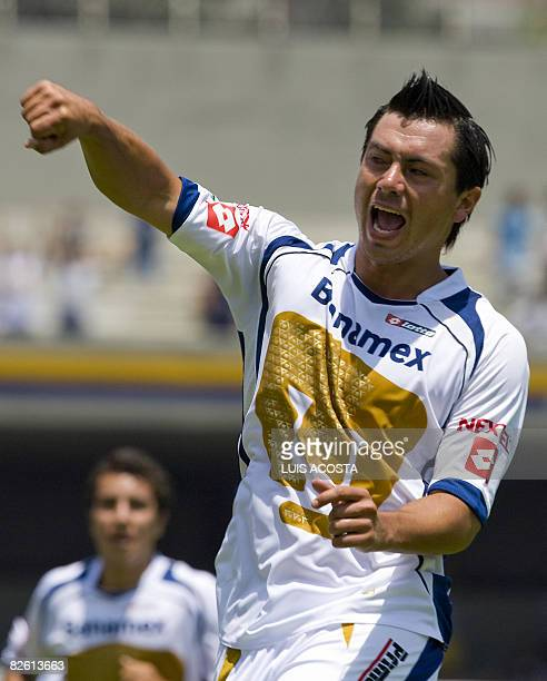Pumas' Juan Carlos Cacho celebrates after scoring his second goal against Atlas during their Mexican football league match in Mexico City on August...