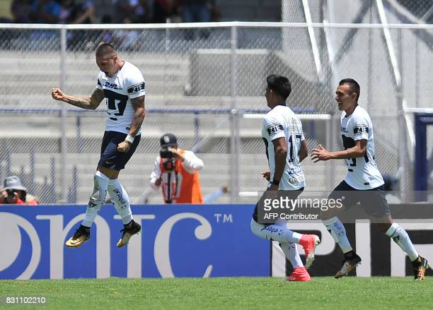 Pumas' Nicolas Castillo celebrates after scoring against Lobos Buap during their Mexican Torneo Apertura 2017 football match at the University...