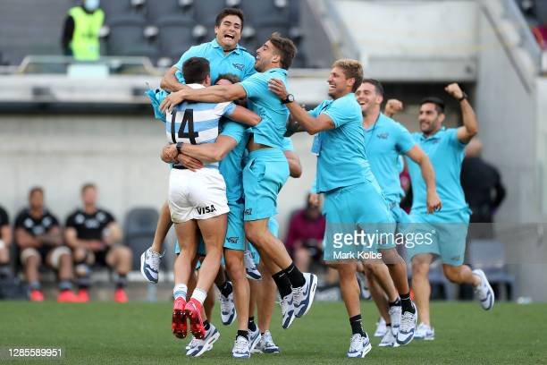 Pumas players celebrate after winning the 2020 Tri-Nations rugby match between the New Zealand All Blacks and the Argentina Los Pumas at Bankwest...