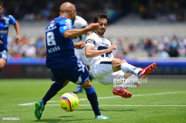 Pumas' Spanish defender Alejandro Arribas vies for the ball with Puebla's midfielder Francisco Acuna during their Mexican Clausura tournament...