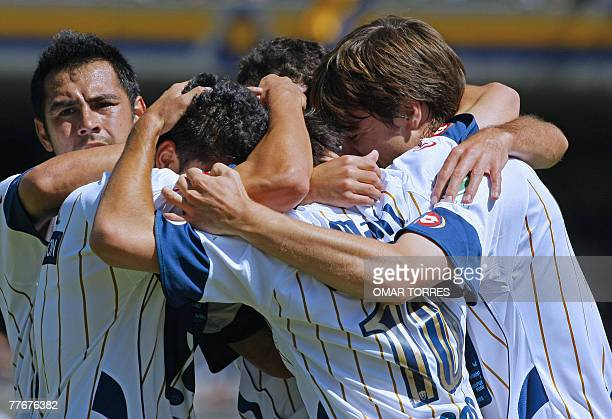 Pumasplayers celebrate the fourth goal of the team against Veracruz scored by Ignacio Scocco during their Mexican league's Opening Tournament 16th...