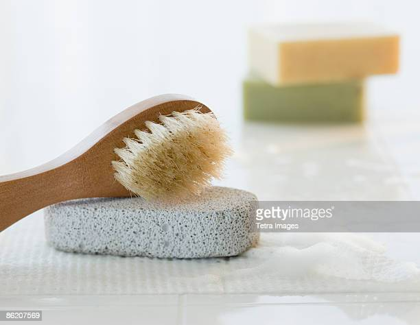 Pumice stone, body brush, and soap