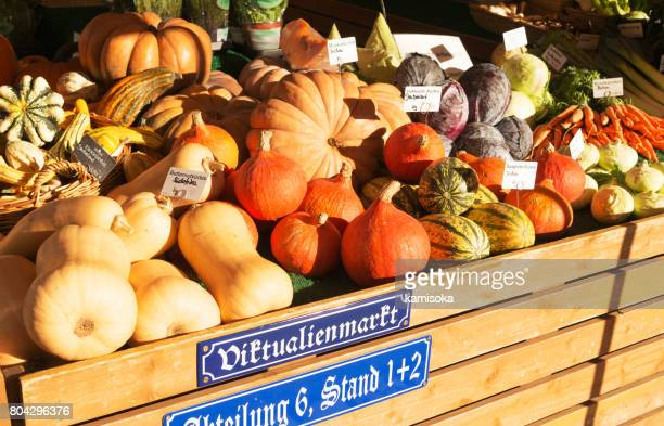 pumkin for sale at the viktualienmarkt in munich, germany - viktualienmarkt stock pictures, royalty-free photos & images