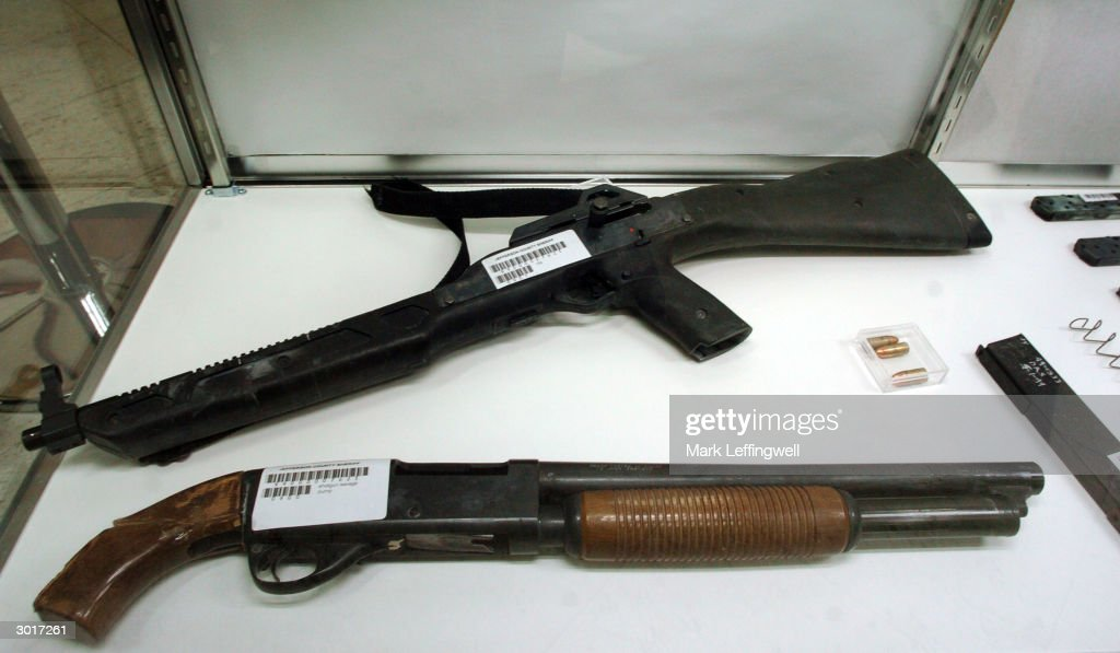 A pump action shotgun and assult rifle used in the 1999 Columbine High School shooting are shown on display at the Jefferson County Fairgrounds February 26, 2004 in Golden, Colorado. Columbine students Eric Harris and Dylan Klebold killed 13 people at Columbine High School April 20, 1999 in Littleton, Colorado in the worst school shooting in U.S. history.