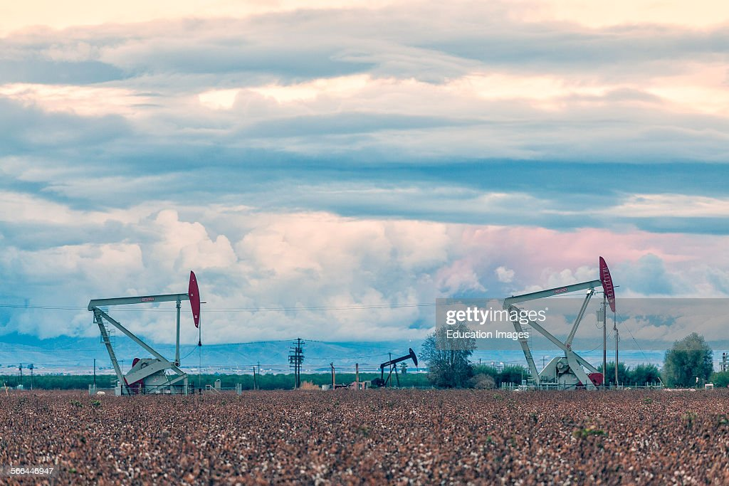 Oil well and fracking site on cotton field : News Photo