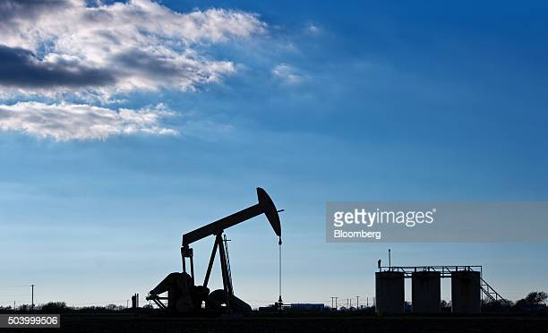 A pump jack operates in an oil field near Corpus Christi Texas US on Thursday Jan 7 2016 Crude oil slid Thursday to the lowest level since December...