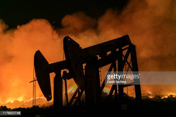 Pump jacks at an oil extraction site are seen at the Maria Fire which exploded to 8000 acres on its first night on November 1 2019 near Somis...