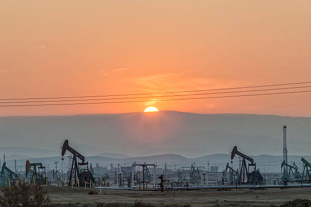 Pump jacks at the Belridge Oil Field and hydraulic fracking site which is the fourth largest oil field in California. Kern County, San Joaquin...