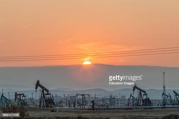 Pump jacks at the Belridge Oil Field and hydraulic fracking site which is the fourth largest oil field in California Kern County San Joaquin Valley...