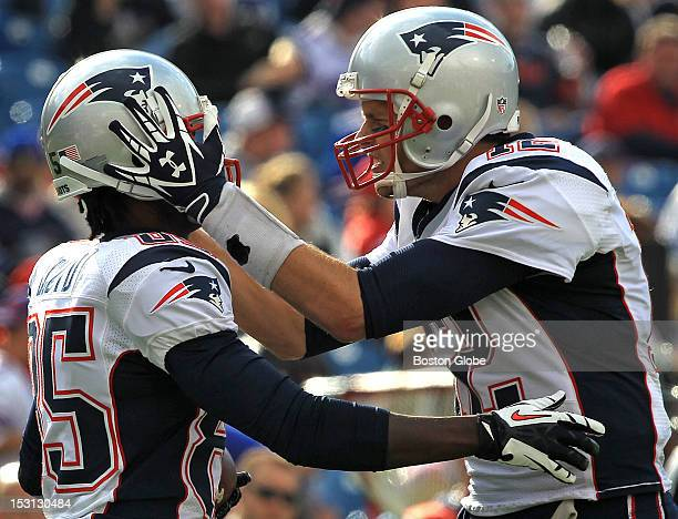 A pumped up New England Patriots quarterback Tom Brady celebrates with New England Patriots wide receiver Brandon Lloyd after a 25yard pass and...