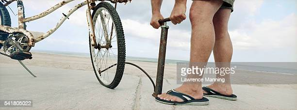 pumping air into bicycle tire - air pump stock photos and pictures