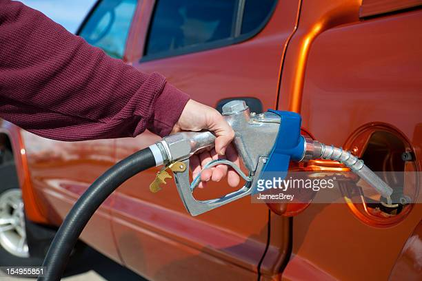 Pumping Expensive Gasoline into Gas Tank