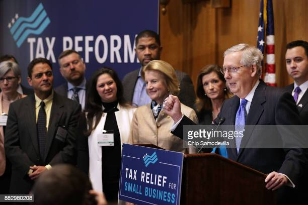 Pumping his fist Senate Majority Leader Mitch McConnell addresses a tax reform news conference with Sen Shelley Moore Capito and representatives from...