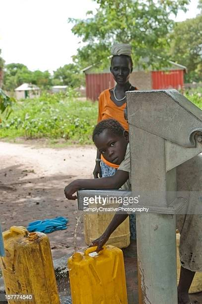 pumping water in south sudan, africa. - south sudan stock pictures, royalty-free photos & images