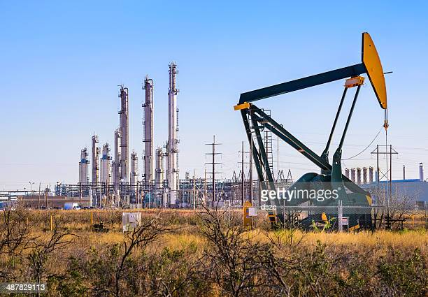 pumpjack (oil derrick) and refinery plant in west texas - oil stock pictures, royalty-free photos & images