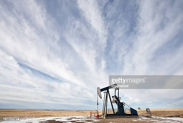 pumpjack on the plains - undone stock pictures, royalty-free photos & images