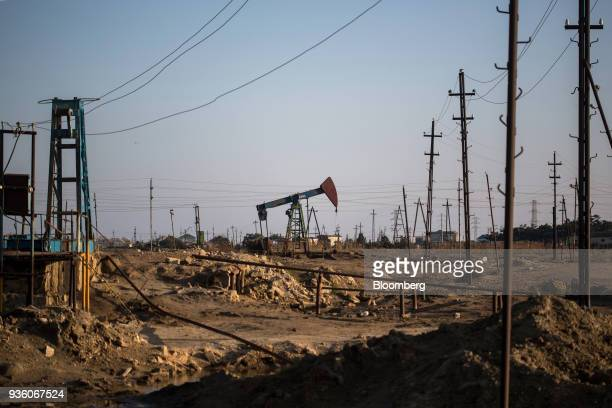 A pumpjack operates in a field in Baku Azerbaijan on Sunday March 18 2018 Two years after descending into junk Azerbaijan's shortest path to winning...