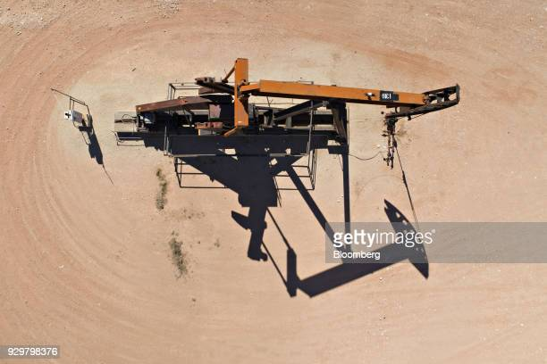 A pumpjack operates on an oil well in the Permian Basin in this aerial photograph taken over Crane Texas US on Friday March 2 2018 Chevron the...